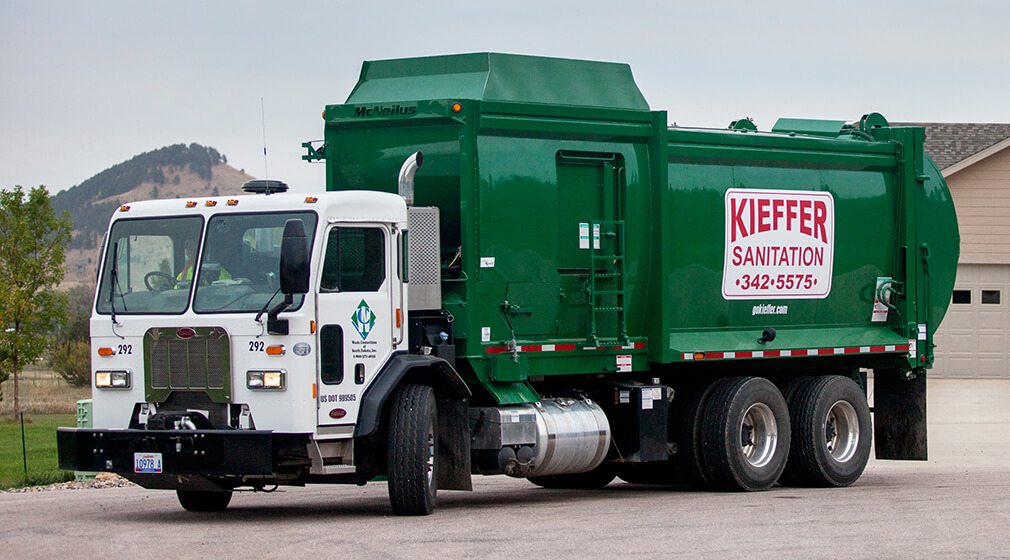 Photo of a Kieffer Sanitation truck leaving a residential home.